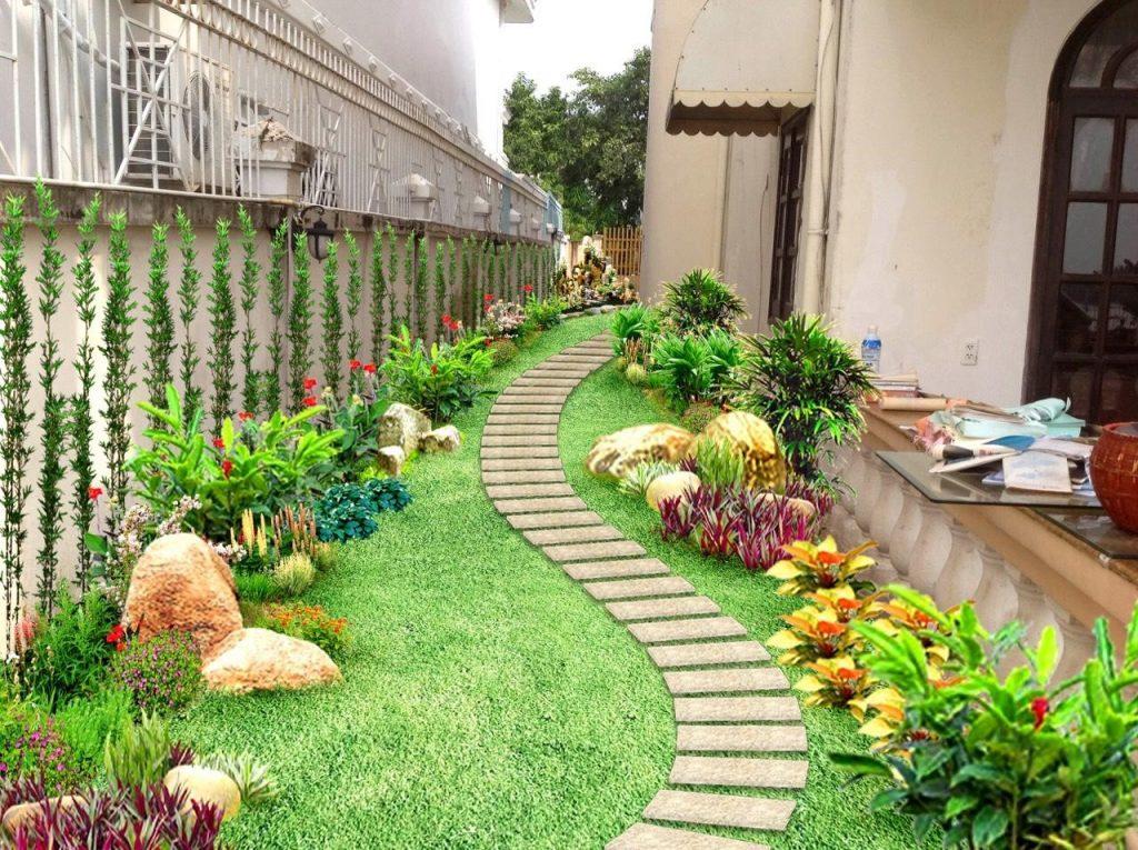 Tiểu cảnh sân vườn với lối đi trải thảm cỏ và lát đá